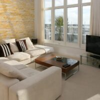 Modern furnished living room with plasma TV